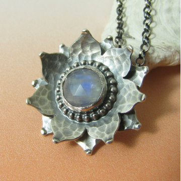 Sterling silver and rainbow moonstone lotus necklace.
